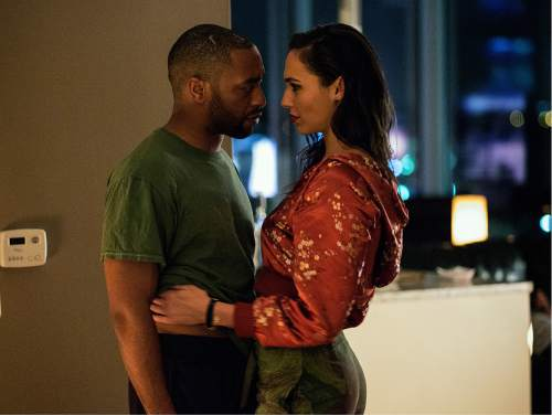 "This image released by Open Road Films shows Chiwetel Ejiofor, left, Gal Gadot in a scene from ""Triple 9."" (Bob Mahoney/Open Road Films via AP)"