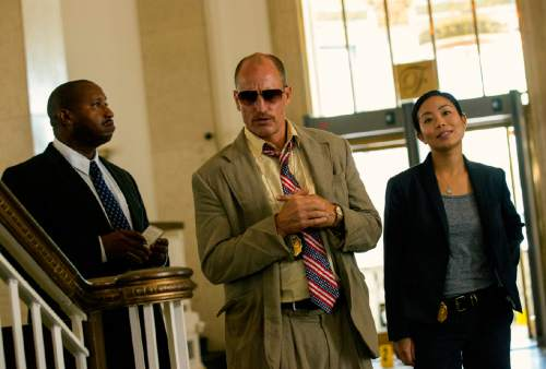 "This image released by Open Road Films shows Terence Rosemore, from left, Woody Harrelson and Michelle Ang in a scene from ""Triple 9."" (Bob Mahoney/Open Road Films via AP)"