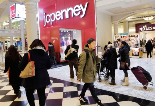 FILE - In this Feb. 19, 2015, file photo, shoppers visit a J.C. Penney store in New York. The Texas-based retailer reports quarterly financial results, Friday, Feb. 26, 2016. (AP Photo/Mark Lennihan, File)