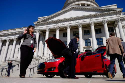Francisco Kjolseth  |  The Salt Lake Tribune  Rep. Kim Coleman, R-West Jordan, left, tours a Tesla Model S in front of the Utah Capitol on Tuesday, March, 10, 2015, the day after the House of Representatives rejected her legislation HB394 to eliminate the current prohibition against manufacturers owning a dealership in the state. Currently they have to go through third-party franchises.