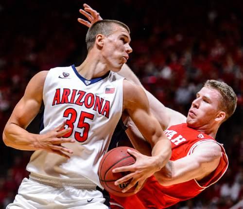 Trent Nelson  |  The Salt Lake Tribune Arizona Wildcats center Kaleb Tarczewski (35) runs into Utah Utes forward Jakob Poeltl (42) as Utah hosts Arizona, NCAA basketball at the Huntsman Center in Salt Lake City, Saturday February 27, 2016.