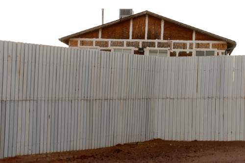 Trent Nelson  |  The Salt Lake Tribune A wall surrounds the compound housing the FLDS bishop's storehouse in Colorado City, AZ, Thursday February 25, 2016.