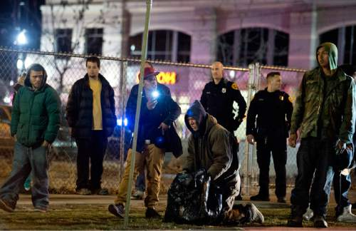Lennie Mahler  |  The Salt Lake Tribune  Selam Mohammad records with a cell phone the events of Saturday, Feb. 27, 2016, following the police shooting of 17-year-old Abdi Mohamed. Police arrive to disperse a crowd that had formed in downtown Salt Lake City.