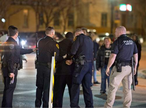 Lennie Mahler  |  The Salt Lake Tribune  Police arrest a man after a crowd formed protesting the officer-involved shooting of 17-year-old Abdi Mohamed at 200 South Rio Grande Street in Salt Lake City, Saturday, Feb. 27, 2016.