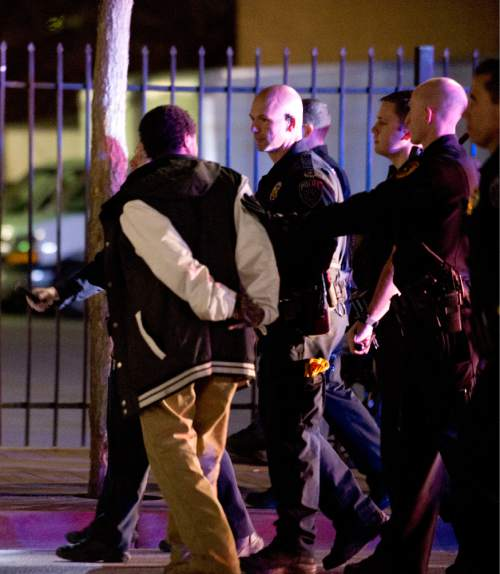Lennie Mahler  |  The Salt Lake Tribune  Police arrest a man in an angry crowd that formed after an officer-involved shooting at 200 South Rio Grande Street in Salt Lake City, Saturday, Feb. 27, 2016.