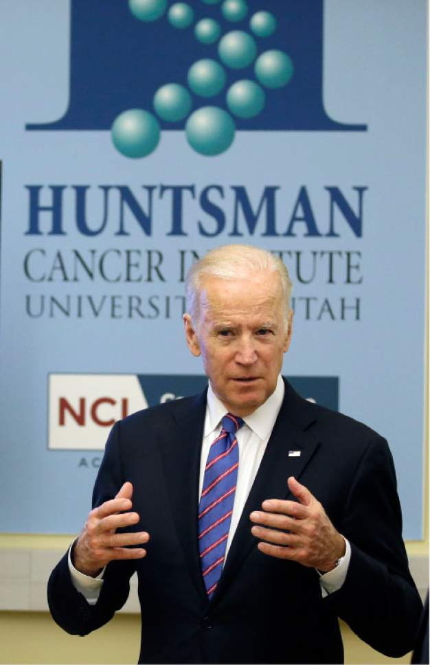 """Vice President Joe Biden speaks during a tour of the research lab at the Huntsman Cancer Institute Friday, Feb. 26, 2016, in Salt Lake City, as part of the White House's cancer """"moonshot,"""" an ambitious effort to double the rate of progress toward curing cancer and ramp up federally funded research on the disease. Working toward a cure for cancer is personal for Biden, whose 46-year-old son, former Delaware state Attorney General Beau Biden, died from brain cancer in May. (AP Photo/Rick Bowmer, Pool)"""