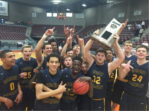 Trevor Phibbs  |  The Salt Lake Tribune  Summit Academy players hold the 2A championship trophy.