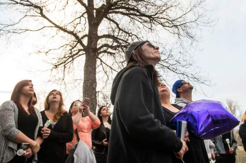 Chris Detrick  |  The Salt Lake Tribune Whitney Bodell watches the balloons rise into the sky during a vigil for her girlfriend Hope Gabaldon at Liberty Park Sunday February 28, 2016. Gabaldon, 21, was found mortally wounded in the city on Thursday night. West Valley City police, working with law enforcement in Denver, found and detained a person of interest Sunday afternoon, according to a news release.