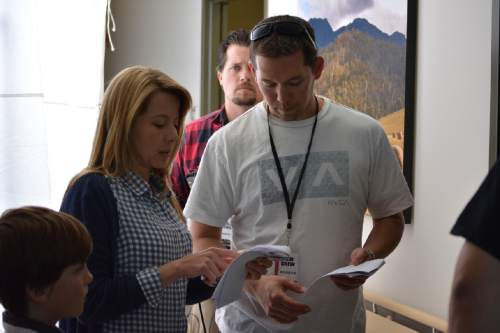 """   Candlelight Media Group  Director/producer Brian Brough (right) talks with lead actor Sarah Kent on the set of the drama """"Singing With Angels,"""" the first narrative film to feature the Mormon Tabernacle Choir."""