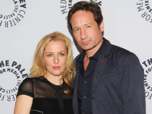 "FILE - In this Oct. 12, 2013 file photo, actors Gillian Anderson and David Duchovny attend ""The Truth Is Here: David Duchovny and Gillian Anderson on The X-Files"" at The Paley Center for Media, in New York. Fox announced Tuesday, March 24, 2015, that it will air a six-episode run of new episodes of ""The X-Files"" that will begin this summer. Stars Duchovny and Anderson will reprise their roles as FBI agents Fox Mulder and Dana Scully. (Photo by Evan Agostini/Invision/AP, File)"