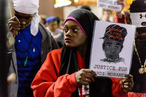 Trent Nelson     The Salt Lake Tribune Protesters gather at the Wallace Bennett Federal Building to protest the police shooting of 17-year-old Abdi Mohamed on Saturday night, Monday February 29, 2016.