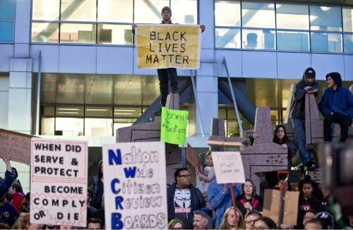 Lennie Mahler     The Salt Lake Tribune  A crowd gathers at the Wallace Bennett Federal Building in Salt Lake City on Monday following the police shooting of 17-year-old Abdi Mohamed on Saturday.