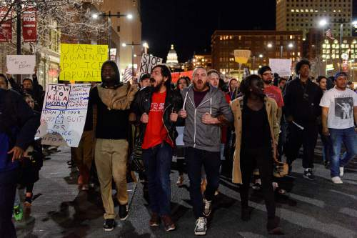 Trent Nelson  |  The Salt Lake Tribune Activists march to the Public Safety Building to protest the police shooting of 17-year-old Abdi Mohamed, Monday February 29, 2016.