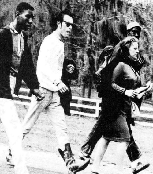 """Viola Liuzzo carries her shoes while walking with other civil rights activist before she was shot and killed in Alabama. Liuzzo-Prado (Viola's daughter) says her mother walked barefoot whenever she could. 'She just hated shoes.' When her body was removed from the car she was shot in, she was barefoot."" (Courtesy of Pygmalion Productions)"