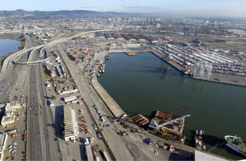 FILE - A deep water port is under development at the former Oakland Army Base, pictured here in 2008 at the foot of the San Francisco Bay Bridge. Utah has loaned four coal-producing counties $53 million to buy into the project to guarantee export throughput for coal and other commodities produced in central Utah. But coal shipments might not be welcome in Oakland. (AP Photo/Bay Area News Group, Laura A. Oda)