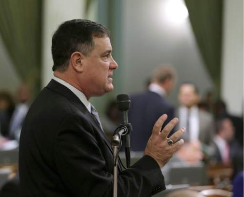 Saying it was a matter of freedom of choice, Assemblyman Donald Wagner, R-Irvine, urges lawmakers to reject a measure raising the smoking age from 18 to 21, Thursday, March 3, 2016, in Sacramento, Calif. The bill by Assemblyman Jim Wood, D-Healdsburg, was part of a package aimed at restricting access to tobacco. Assembly approved the bill and sent it to the Senate.(AP Photo/Rich Pedroncelli)