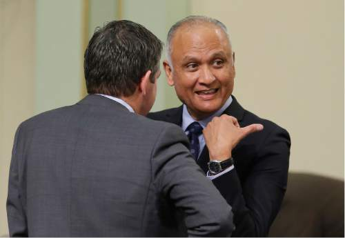 State Sen. Ed Hernandez, D-Azusa, right, talks with Assemblyman Jim Wood, D-Healdsburg, after their bill to raise the smoking age from 18 to 21 was approved by the Assembly at the Capitol, Thursday, March 3, 2016, in Sacramento, Calif. The measure, part of a package of bills aimed at restricting access to tobacco, now goes to the Senate.(AP Photo/Rich Pedroncelli)