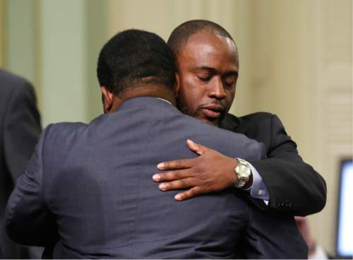Assemblyman Tony Thurmond, D-Richmond, right, is congratulated by Assembly Sebastian Ridley-Thomas, D-Los Angeles, after his measure requiring all schools, including charters schools, to be tobacco-free, was approved by the Assembly Thursday, March 3, 2016, in Sacramento, Calif. The bill, part of a package of bills aimed at restricting access to tobacco, now goes to the Senate.(AP Photo/Rich Pedroncelli)