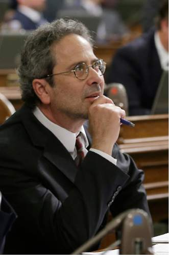 Assemblyman Richard Bloom, R-Santa Monica, watches as the votes are posted for his bill to allow counties to raise their own cigarette taxes beyond the state's levy of $0.87 per pack, Thursday, March 3, 2016, in Sacramento, Calif. The bill, part of a package of bills aimed at restricting access to tobacco, now goes to the Senate.(AP Photo/Rich Pedroncelli)