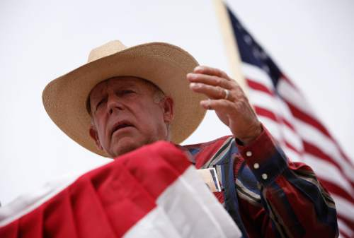 FILE - Rancher Cliven Bundy speaks at a protest camp near Bunkerville, Nev. Friday, April 18, 2014.  (AP Photo/Las Vegas Review-Journal, John Locher)