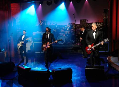"In this image released by CBS, The Foo Fighters perform during a taping of David Letterman's final ""Late Show with David Letterman,"" Wednesday, May 20, 2015 at the Ed Sullivan Theater in New York. After 33 years in late night television, 6,028 broadcasts, nearly 20,000 total guest appearances, 16 Emmy Awards and more than 4,600 career Top Ten Lists, David Letterman is retiring. (Jeffrey R. Staab/CBS via AP)"