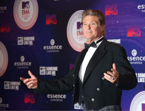 "FILE - In this Nov. 9, 2014 file photo, actor David Hasselhoff poses for photographers upon arrival at the 2014 MTV European Music Awards in Glasgow. Hasselhoff will be making a big splash on TV next month. To mark the American debut of his U.K. series, ""Hoff the Record,"" on AXS TV, the channel says it will salute the ""Baywatch"" star with a March 26, 2016, mini-marathon starting at 3 p.m. EST. (Photo by Joel Ryan/Invision/AP, File)"