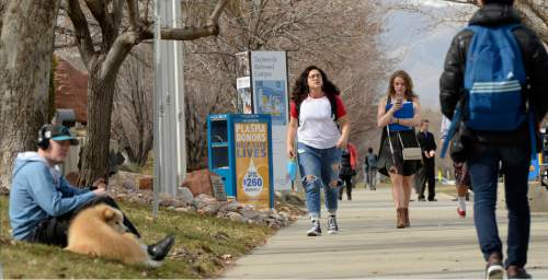 Al Hartmann  |  The Salt Lake Tribune Students at Salt Lake Community College walk to class Thursday March 3 at the Redwood campus. Starting next fall, the college will cover tuition for  students with federal Pell grants who commit to attending fulltime, it announced Thursday.