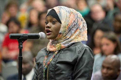 "Lennie Mahler  |  The Salt Lake Tribune  Muslima Aden, cousin of Abdi Mohamed, asks questions of the Salt Lake City Human Rights Commission and city officials Wednesday during a ""listening session"" held at the Marmalade library."