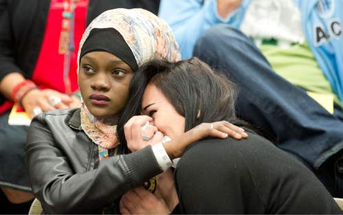 "Lennie Mahler  |  The Salt Lake Tribune  Muslima Aden, cousin of Abdi Mohamed, consoles Becca Monson, girlfriend of Abdi Mohamed, as the Salt Lake City Human Rights Commission and city officials hosted a ""listening session"" held at the Marmalade library Wednesday, March 2, 2016."