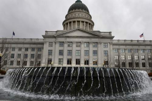 Scott Sommerdorf   |  The Salt Lake Tribune An approaching storm blows the waters in the Capitol fountain sideways, Wednesday, Feb. 19, 2014.