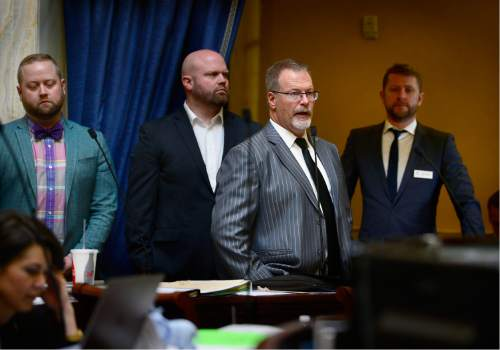 Scott Sommerdorf   |  The Salt Lake Tribune   With assault victim Taylor Lamont at far left, and Equality Utah Executive Director Troy Williams at right, Senator Stephen Urquhart, R-StGeorge, speaks to his bill HB107 - Hate Crimes - in the Utah Senate, Wednesday, March 2, 2016.