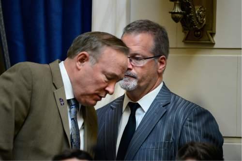 Scott Sommerdorf   |  The Salt Lake Tribune   Senator Jim Dabakis, D-Salt Lake, left, confers with Senator Stephen Urquhart, R-StGeorge, prior to HB107 - Hate Crimes - being called up in the Utah Senate, Wednesday, March 2, 2016.
