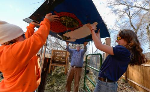 Francisco Kjolseth   The Salt Lake Tribune Amelia Costin, left, and Katelinn Mix, help Intro to Agriculture teacher Bill Carpenter with a load of hay for the student-owned steers. At Roots, Utah's first farm-based charter school, in West Valley City, students get hands-on experience working at the school's farm just down the street. A legislative task force is recommending changes to the way Utah's charter schools are funded.