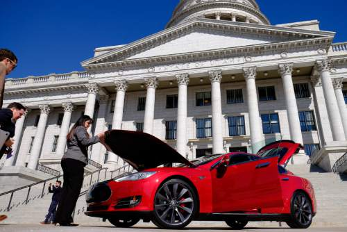 Francisco Kjolseth  | Tribune file photo Rep. Kim Coleman, R-West Jordan, left, tours a Tesla Model S in front of the Utah Capitol last March, the day after the House defeated her legislation HB394 to remove the current prohibition on manufacturers owning a dealership in the state. Currently they have to go through third-party franchises.