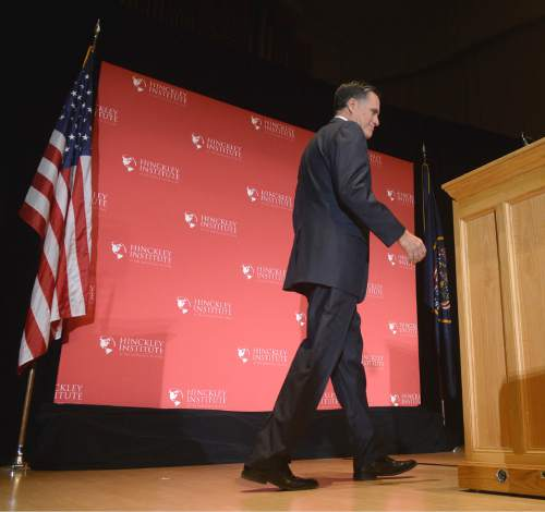 Al Hartmann  |  The Salt Lake Tribune Former presidential candidate Mitt Romney walks across stage at Libby Gardner Hall to make a speech about the state of the 2016 presidential race and Donald Trump at the Hinckley Insitute of Politics at the University of Utah Thursday March 3.