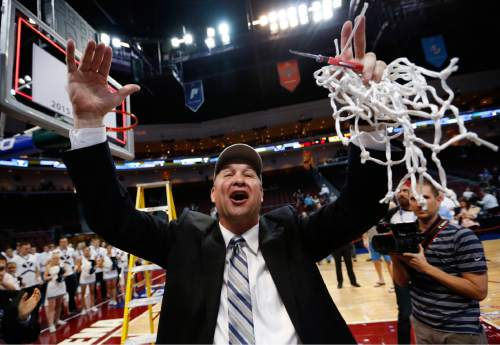 BYU's head coach Jeff Judkins celebrates after his team defeated San Francisco in the West Coast Conference tournament women's championship NCAA college basketball game Tuesday, March 10, 2015, in Las Vegas. (AP Photo/John Locher)