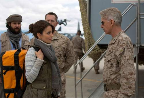 """In this image released by Paramount Pictures, Christopher Abbott portrays Fahim Ahmadzai, from left, Tina Fey portrays Kim Baker and Billy Bob Thornton portrays Gen. Hollanek in a scene from """"Whiskey Tango Foxtrot."""" (Frank Masi/Paramount Pictures and Broadway Video/Little Stranger Productions via AP)"""