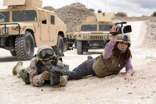 """In this image released by Paramount Pictures, Evan Jonigkeit portrays Spc. Coughlin, left, and Tina Fey portrays Kim Baker in a scene from """"Whiskey Tango Foxtrot."""" (Frank Masi/Paramount Pictures and Broadway Video/Little Stranger Productions via AP)"""