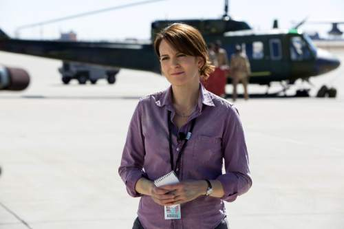 """In this image released by Paramount Pictures, Tina Fey portrays Kim Baker in a scene from """"Whiskey Tango Foxtrot."""" (Frank Masi/Paramount Pictures and Broadway Video/Little Stranger Productions via AP)"""