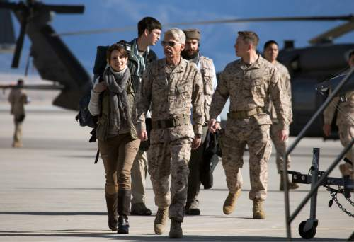 """In this image released by Paramount Pictures, Tina Fey portrays Kim Baker, left, and Billy Bob Thornton portrays Gen. Hollanek in a scene from """"Whiskey Tango Foxtrot."""" (Frank Masi/Paramount Pictures and Broadway Video/Little Stranger Productions via AP)"""
