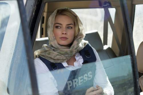 """In this image released by Paramount Pictures, Margot Robbie portrays Tanya Vanderpoel in a scene from """"Whiskey Tango Foxtrot."""" (Frank Masi/Paramount Pictures and Broadway Video/Little Stranger Productions via AP)"""