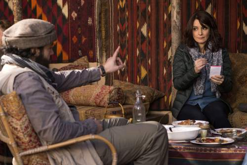 """In this image released by Paramount Pictures, Christopher Abbott portrays Fahim Ahmadzai, left, and Tina Fey portrays Kim Baker in a scene from """"Whiskey Tango Foxtrot."""" (Frank Masi/Paramount Pictures and Broadway Video/Little Stranger Productions via AP)"""