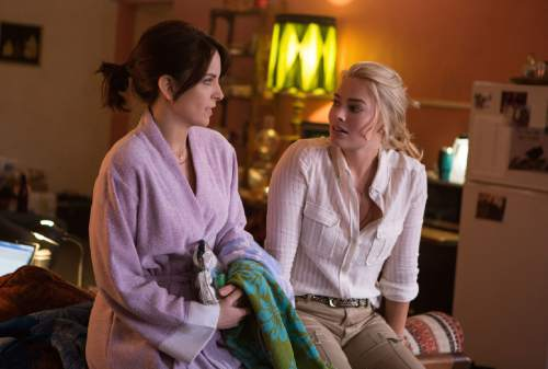 """In this image released by Paramount Pictures, Tina Fey portrays Kim Baker, left, and Margot Robbie portrays Tanya Vanderpoel in a scene from """"Whiskey Tango Foxtrot."""" (Frank Masi/Paramount Pictures and Broadway Video/Little Stranger Productions via AP)"""