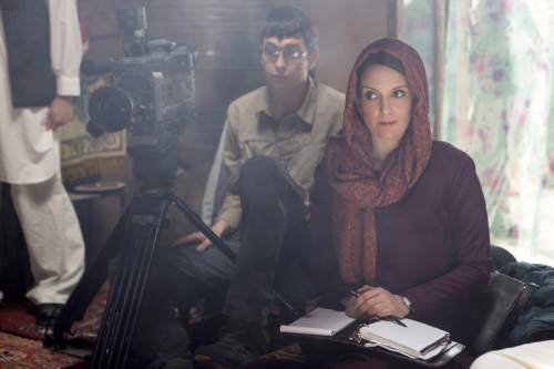 """In this image released by Paramount Pictures, Nicholas Braun portrays Tall Brian, left, and Tina Fey portrays Kim Baker in a scene from """"Whiskey Tango Foxtrot."""" (Frank Masi/Paramount Pictures and Broadway Video/Little Stranger Productions via AP)"""