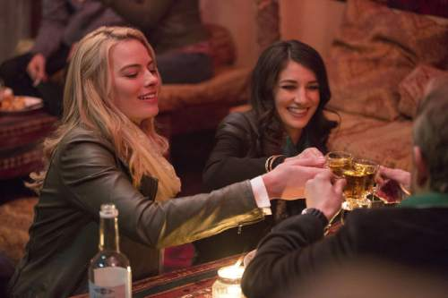 """In this image released by Paramount Pictures, Margot Robbie portrays Tanya Vanderpoel, left, and Sheila Vand portrays Shakira Khar in a scene from """"Whiskey Tango Foxtrot."""" (Frank Masi/Paramount Pictures and Broadway Video/Little Stranger Productions via AP)"""