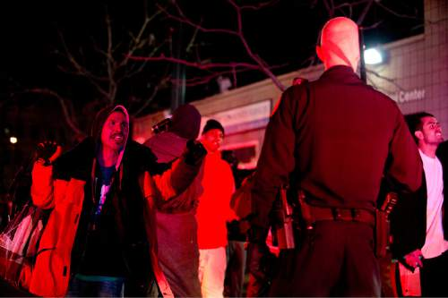 Lennie Mahler  |  The Salt Lake Tribune  A man shouts at a police officer following an officer-involved shooting at 200 South Rio Grande Street in Salt Lake City, Saturday, Feb. 27, 2016.