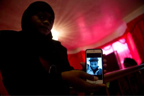 Lennie Mahler  |  The Salt Lake Tribune  Muslima Aden shows a photo of her cousin, Abdi Mohamed, from her phone Friday, March 4, 2016.