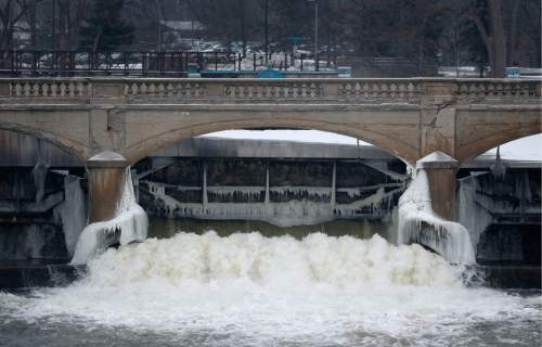 FILE - In this Jan. 21, 2016 file photo, water from the Flint River flows through the Hamilton Dam near downtown Flint, Mich. The state of Michigan restricted Flint from switching water sources last April unless it got approval from Gov. Rick Snyder's administration under the terms of a $7 million loan needed to help transition the city from state management, according to a document released Wednesday, March 2, 2016. (AP Photo/Paul Sancya, File)