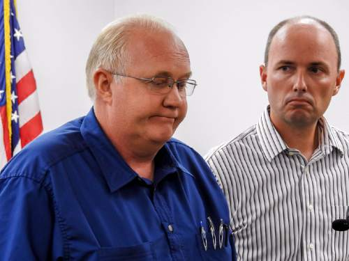 Trent Nelson  |  The Salt Lake Tribune Hildale Mayor Phillip Barlow, left, speaks with Utah Lt. Governor Spencer Cox at right, after nine people were killed and five remained missing Tuesday morning, the day after an SUV and a van were washed off a road during a flash flood in this polygamous Utah-Arizona border community.