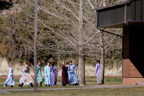 Trent Nelson  |  The Salt Lake Tribune   Girls run and play during recess at an FLDS private school housed in what was previously the public Phelps Elementary School on March 15, 2006. It is now believed to be the Jeffs Academy.